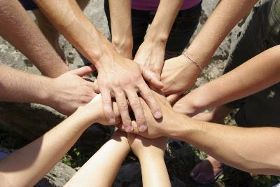 hands reaching in together in a circle