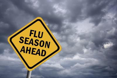 Yellow yield traffic sign showing flu season ahead