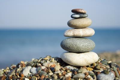 stack of smooth stones with water in background