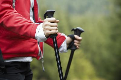 Close up showing hands of older person holding Nordic walking poles