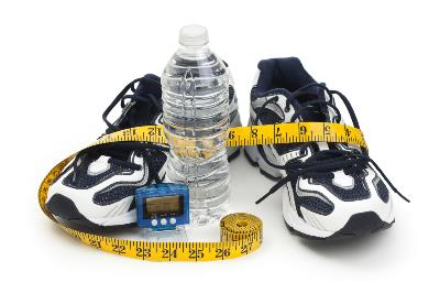 running shoes with pedometer, water bottle and measuring tape